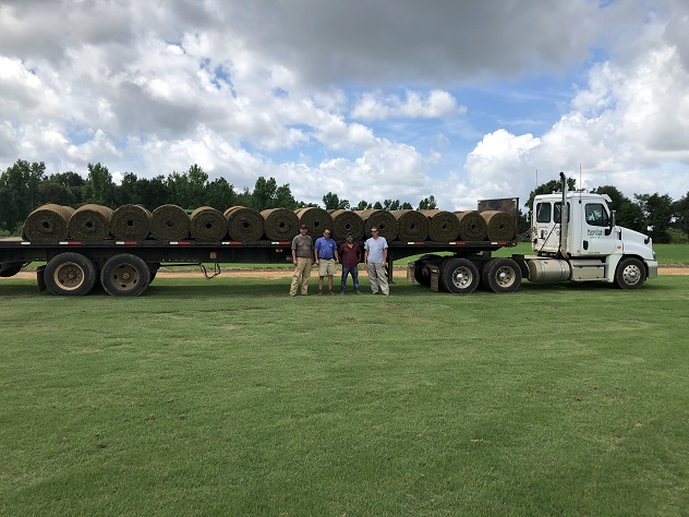 Paradise Turf Farm flatbed semi with turf and drivers